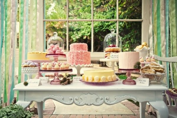 Dessert table. Outside with old window behind. Only just the ruffle cake and lots of little things like macaroons and cupcakes and mini donuts... and a couple macaroon towers