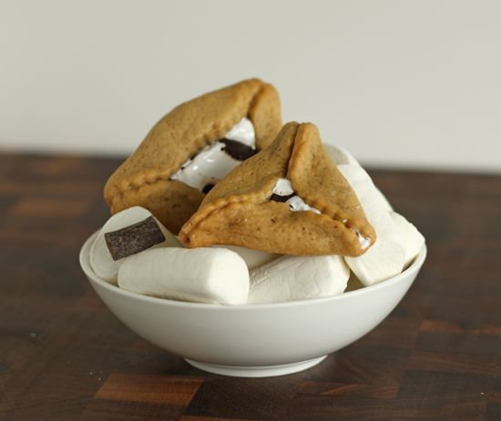 S'more hamentashen. Graham cracker dough with a gooey marshmallow and chocolate center. This sounds interesting. Might have to try this next year.