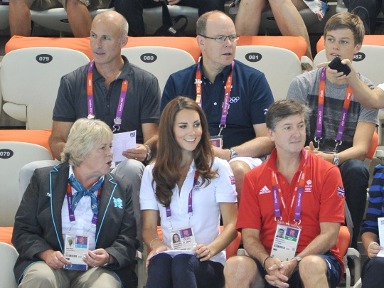 Prince Albert II of Monaco, back center, Kate, Duchess of Cambridge, (FC), & official Team GB ambassador Robin Cousins, (FR), watch synchronized swimming