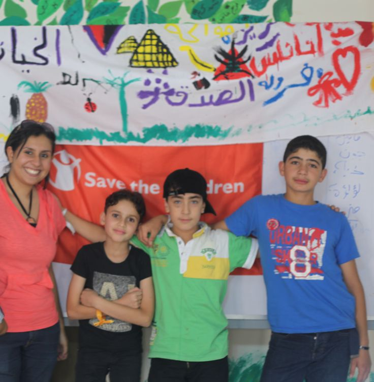 Activities to mark World Refugee Day in Egypt. From right to left – Syrian refugees Ahmed*, 14 years old, and Mohamed*, 12 years old, with Sayed, a 10 year old Egyptian, and Nesma, one of Save the Children's Child Protection Officers. The coexistence workshops have proved to be very successful amongst the children and are hoped to be replicated within new Save the Children projects in future.