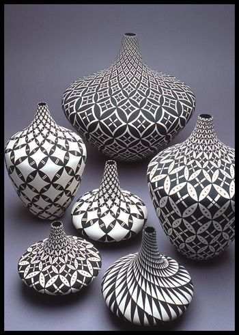 {Makes me want to draw tangles on pottery. Especially love the swirled pattern in lower right corner} Dorothy Torivio group. Acoma Pueblo pottery
