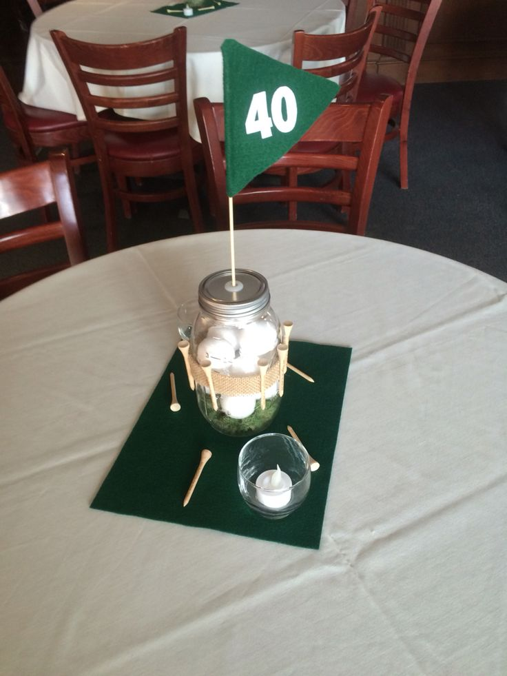 Golf theme centerpieces for 40th birthday party. Tees, flag and balls on turf.