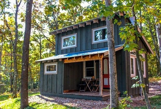 This is a 400 sq. ft. Walden Tiny House by Hobbitat Spaces. They sell the plans you can purchase and download to build it yourself or have a contractor do it for you. One of the few Hobs with 2 ext…