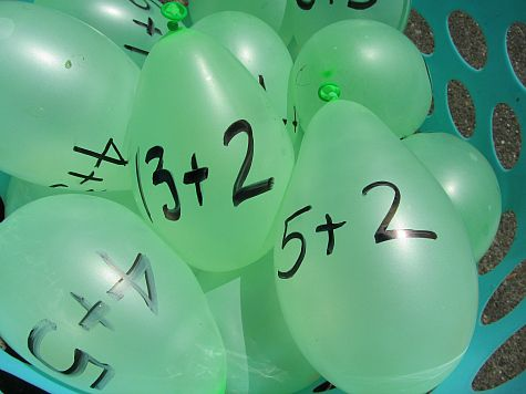 Water Balloon Math - a fun activity to keep kids motivated about learning during the summer!