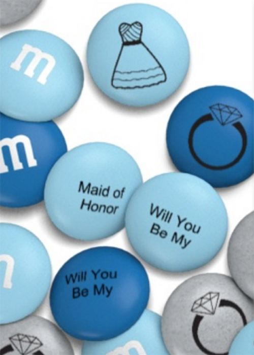 Customize M&Ms in your wedding colors, with some bridal imagery and, of course, the question. Separating the words over a few different M&Ms will make finding the question even more fun — and tasty! (starting at $1.80, My M&Ms