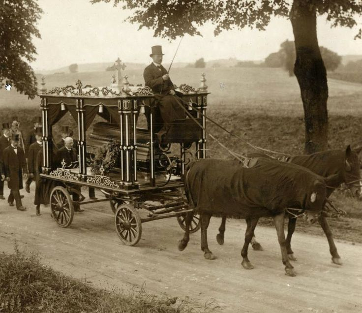 Funeral procession with horse-drawn hearse