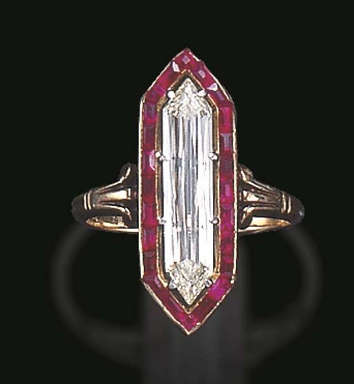 AN ELEGANT BELLE EPOQUE DIAMOND AND RUBY RING  Set with an elongated hexagonal-cut diamond, weighing approximately 2.28 carats, within a calibré-cut ruby surround, to the polished gold decorative shoulder, mounted in gold, circa 1900, with export mark and maker's mark With maker's mark for Braun et Steiner, Austria