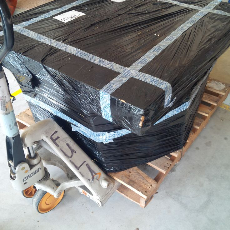 Here's a spectacular example of coin packaging : 9 buckets stacked on a pallet sandwiched between another pallet on the top all strapped and stretch-wrapped together.  Great job!