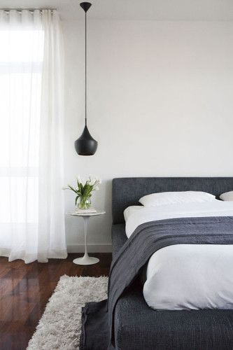 Minimalist bedroom. Love the hanging lamp