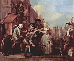 William Hogarth  Rakes Progess he narrowly escapes arrest for debt by Welsh bailiffs (as signified by the leeks, a Welsh emblem, in their hats) as he travels in a sedan chair to a party at St. James's Palace to celebrate Queen Caroline's birthday on Saint David's Day (Saint David is the patron saint of Wales). On this occasion he is saved by the intervention of Sarah Young, the girl he had earlier rejected; she is apparently a dealer in millinery. In comic relief, a man filling a street…