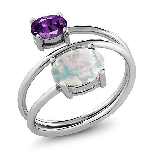 1.75 Ct Oval Cabochon White Simulated Opal Purple Amethyst 925 Sterling Silver Open Ring (Available in size 5, 6, 7, 8, 9). SIMPLY SOPHISTICATED - This delicate ring will immediately put you in the spot light. Crafted with high quality stones this ringis the perfect accessory for any ensemble on any occasion. MESMERIZING DESIGN - This design is simple, classic, elegant, fit for any occasion such as daily wearing home and office. It's carefully packed in beautiful jewelry box making it…