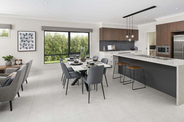 Create a resort style kitchen and living room by using warm timbers and concrete finishes.