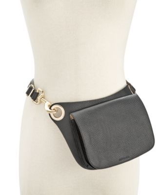 Michael Michael Kors fuses utilitarian hardware and smooth leather on this uniquely functional fanny pack that's perfect for heading out glamorously hands-free.   Leather   Imported   Approximate widt