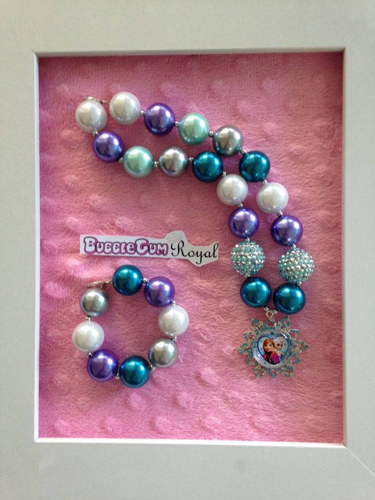 Frozen inspired bubblegum bead necklace with purple, teal, aqua and white beads and an Elsa and Anna pendant $25 + p&h. Matching bracelet $5 with necklace purchase.