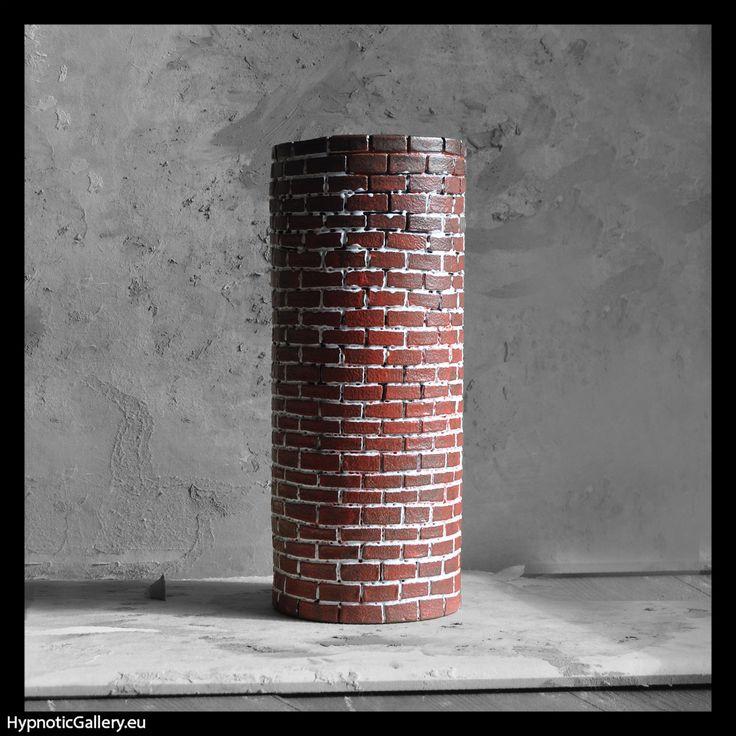 Ceramic vase in shape of old brick chimney. Ceramiczny wazon w formie starego ceglanego komina.