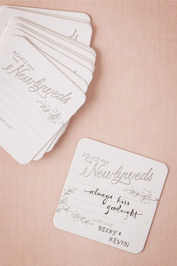 cardboard coasters with advice written on them for newlyweds