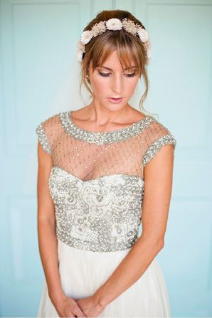 gorgeous beaded and crystal mesh overlay bridal top over sweetheart neckline wedding dress with dreamy bohemian bridal hair updo with soft bangs