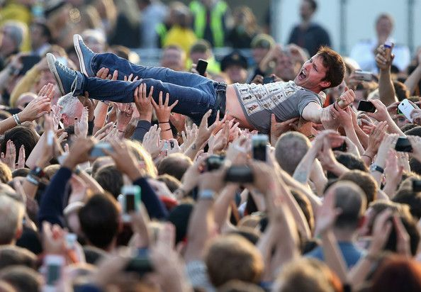 James Blunt Photos Photos - Singer James Blunt crowdsurfs at the Invictus Games Closing Ceremony during the Invictus Games at Queen Elizabeth park on September 14, 2014 in London, England. The International sports event for 'wounded warriors', presented by Jaguar Land Rover was an idea developed by Prince Harry after he visited the Warrior Games in Colorado USA. The four day event has brought together thirteen teams from around the world to compete in nine events such as wheelchair…