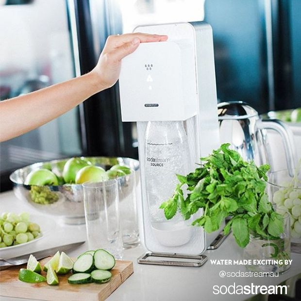 Easily make flat water exciting with the SodaStream sparkling water maker! After fizzing, add a little zing and green to your recipe by mixing fresh lime and basil for a refreshing boost of flavor! There's nothing like cold glass of water to really get you going!
