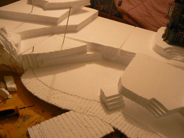 Building a Foam Base for Halloween Boardwalk Village  Same ideas would work great for our Christmas Village