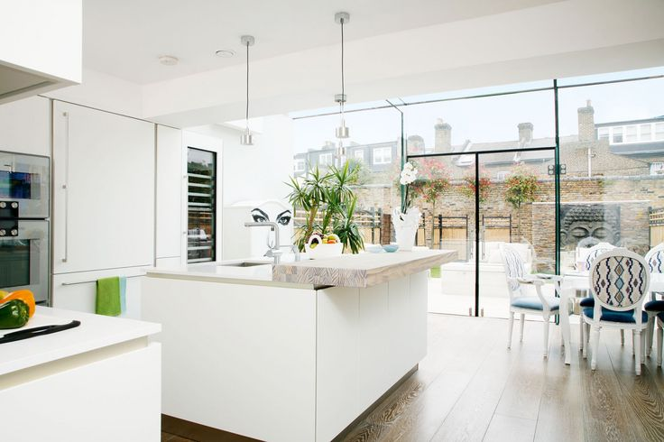 For a light-filled kitchen, Tatiana Karelina and Shawn Frazer chose a modern style to complement their glass extension