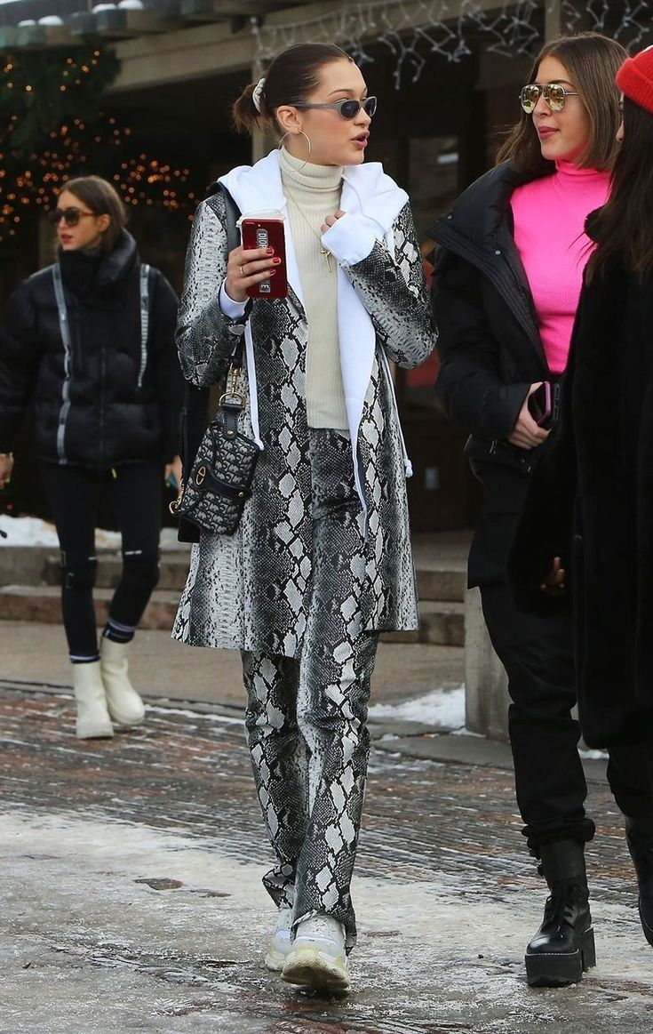 Bella Hadid's Aspen Vacation Look Is Not What We'd Expect  When you thinkaprès-ski style what comes to mind? A trapper hat Fair Isle prints and cozy layers might beone's initial reaction but not if you're Bella Hadid. The supermodel stepped out in Aspenwearing head-to-toe snakeskina head-turning statement even for the popularski destination (which sees its fair share of over-the-top glamour year-round).  Bella's jacket and pants are by I.Am.Giathe affordable label that's blown up thanks to…