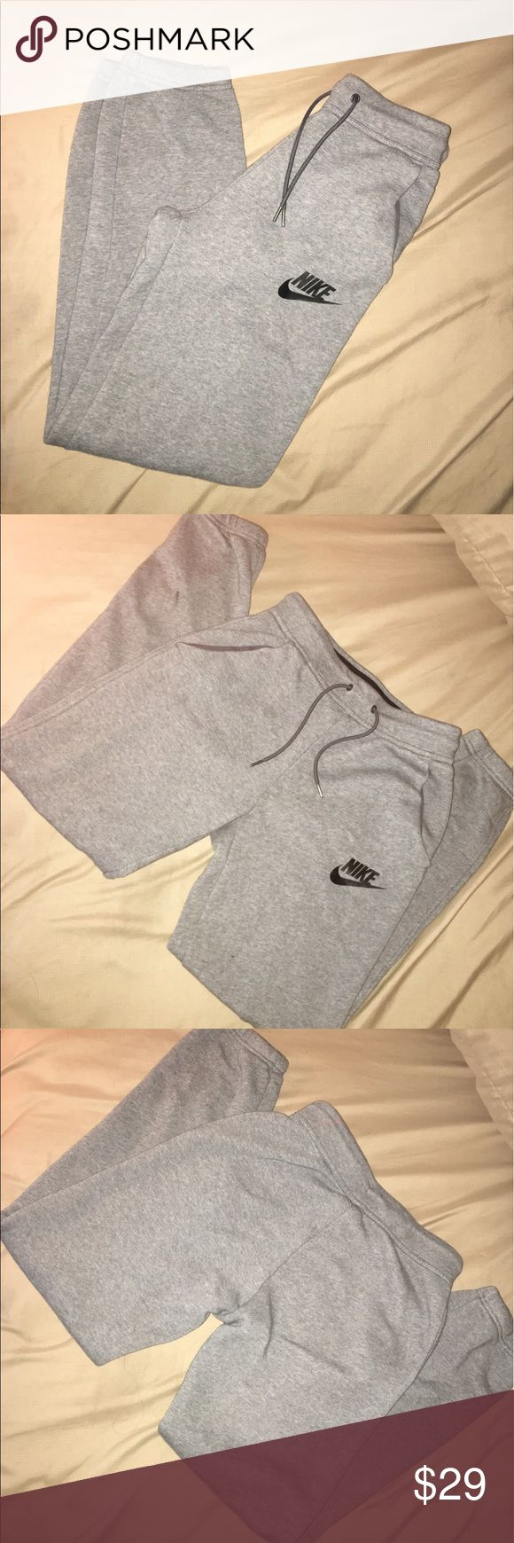 Nike Fleece Joggers Gently used -- great condition -- includes a drawstring and pockets-- perfect for the gym Nike Pants Track Pants & Joggers