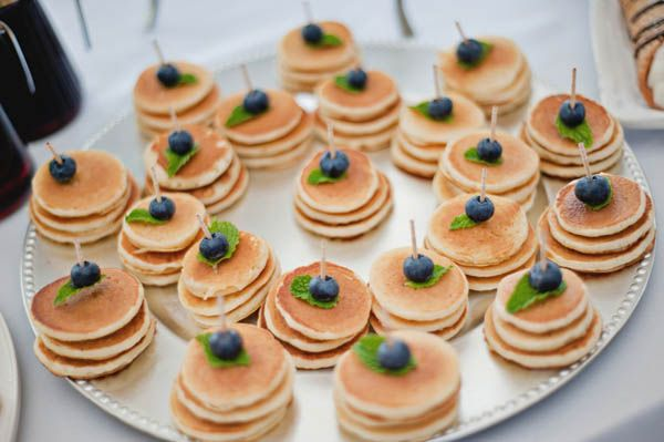 Appetizer presentation, but as waffles, with fruit and bacon and a maple syrup dip