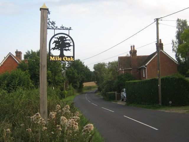 Mile Oak Village Sign      On Mile Oak Road. This very small hamlet of houses around a crossroads has its own village sign.  Kent