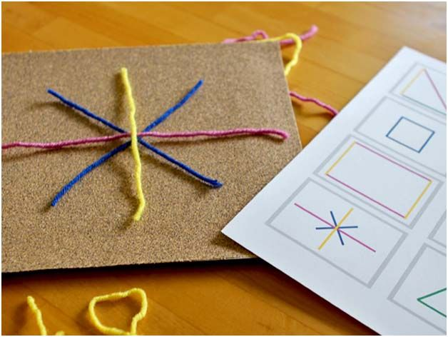 yarn sticks to sandpaper! provide template of letters, shapes, etc for children to recreate