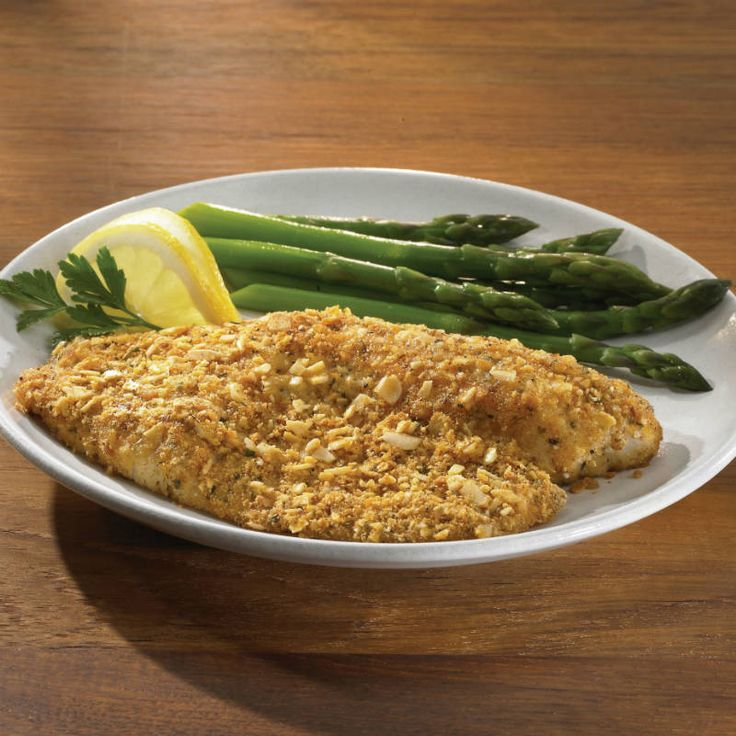 Finely chopped almonds, bread crumbs and Parmesan cheese combine to make a crust for tilapia that's tasty enough for a restaurant menu.