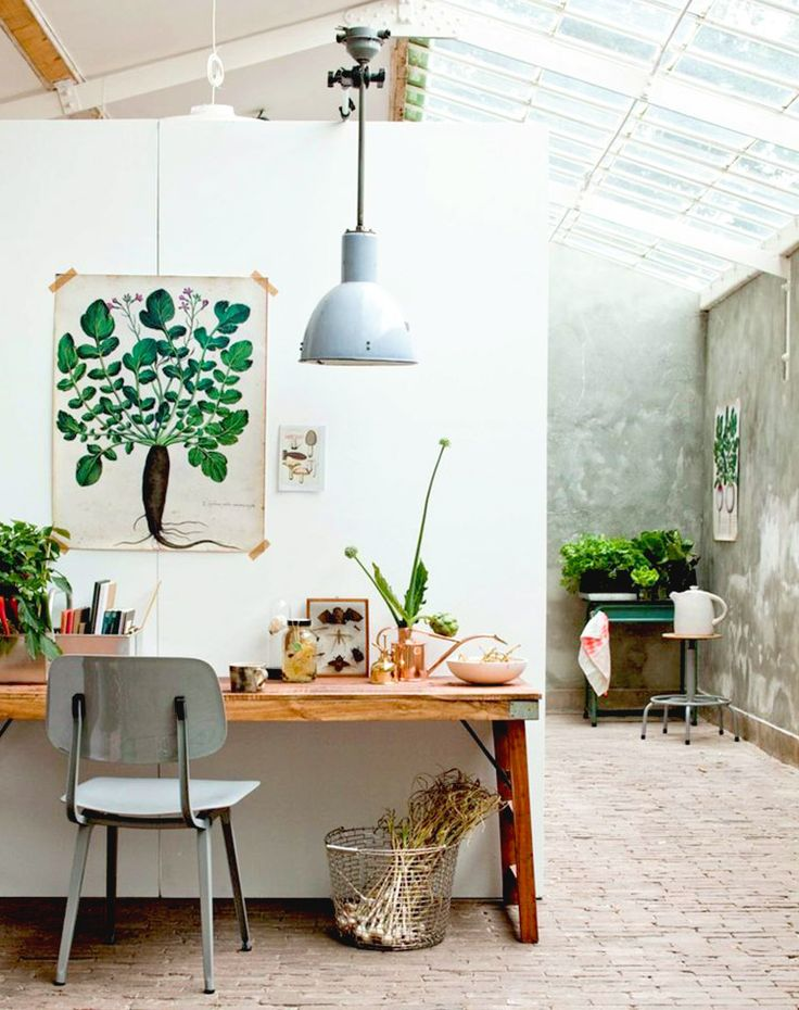 Rustic and earthy home office with plant art