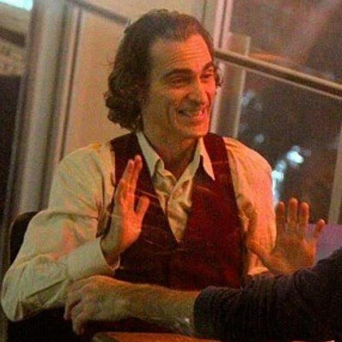 Set pictures of Joaquin Phoenix as Arthur Fleck in Todd
