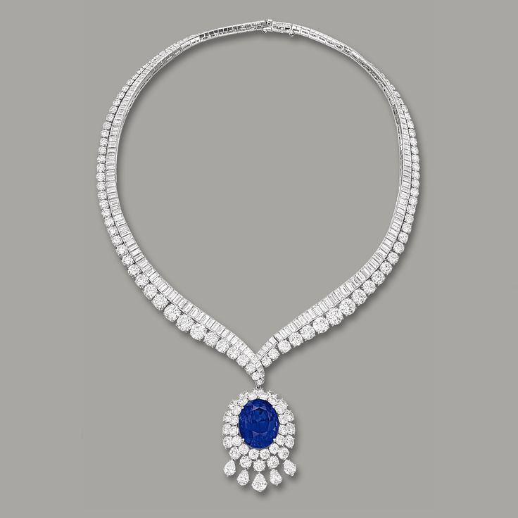 Sapphire and Diamond Necklace, Van Cleef & Arpels: Centring on an oval Ceylon sapphire weighing 42.48 carats, to a double frame set with brilliant-cut diamonds, suspending five pear-shaped diamonds, the necklace channel-set with baguette diamonds, bordered by graduating brilliant-cut diamonds, the diamonds together weighing approx 60.00 carats, mounted with platinum.