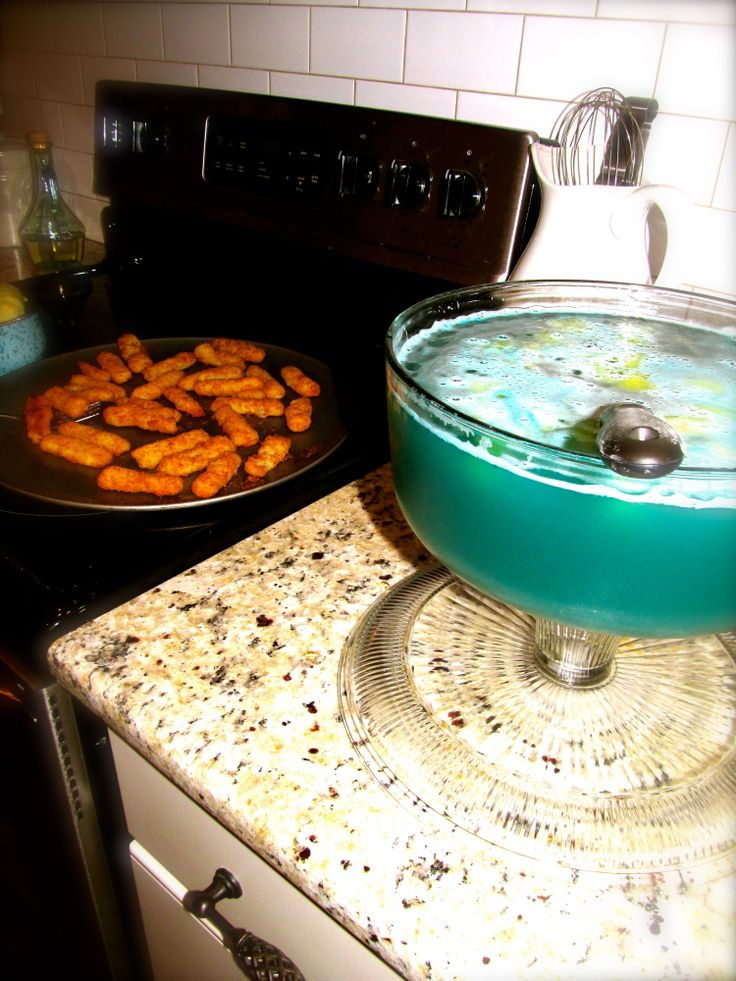 TARDIS punch made with blue Mountain  Dew, Pineapple juice, bits of pineapple and a few drops of blue food coloring.