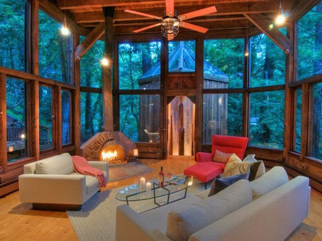 Cool summer nights would look so much better from a glass room like this one. Ultimate muskoka room!