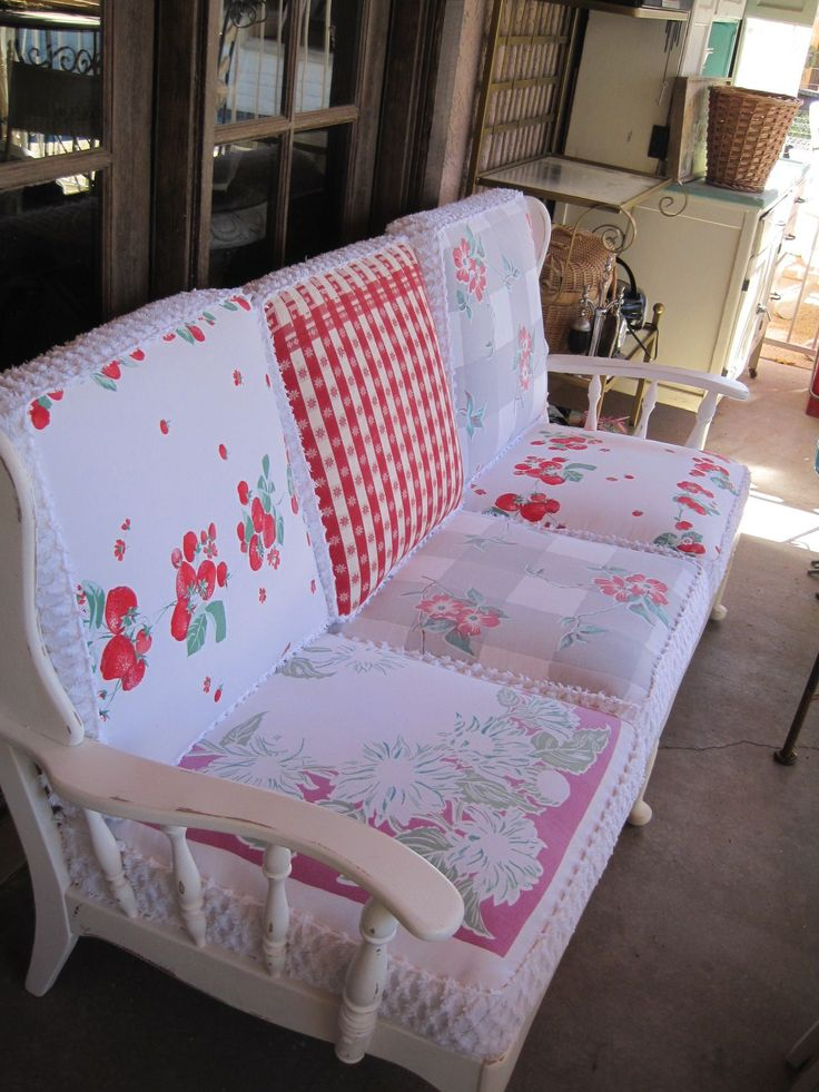 Re-do of a vintage wooden couch.  Cushions were upholstered in vintage tablecloths and chenille bedspread.  I'm in love!