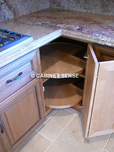 Large corner cabinet with lazy susan angled end cabinet for Angled corner kitchen cabinets