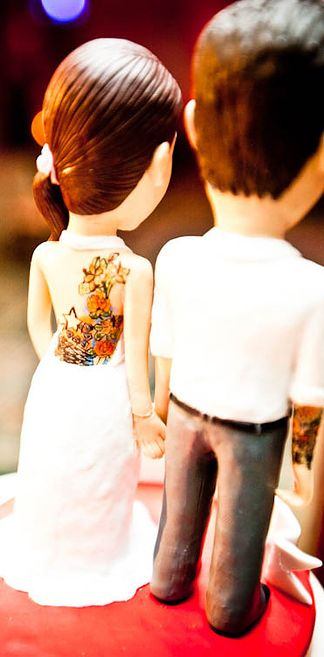 Have a cake topper that actually reflects you guys.   13 Rad Ideas For A Tattoo-Inspired Wedding