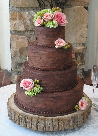 brown rustic wedding cake with roses