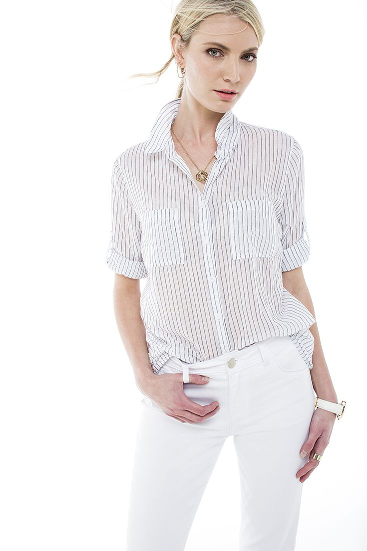 "Our favourite ""boyfriend"" shirt worn with white slim flare denims"