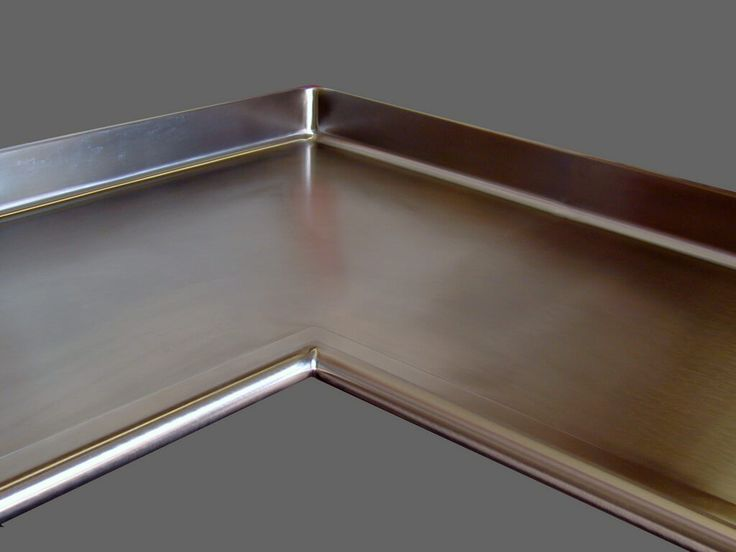Information on stainless steel countertop maintenance, photo gallery of completed stainless steel metal countertops, and design options for your project.