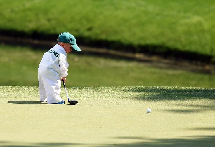 Finn, son of Scott Stallings, plays during the Par 3 Contest at Augusta National Golf Club on April 9, 2014 in Augusta, Georgia.