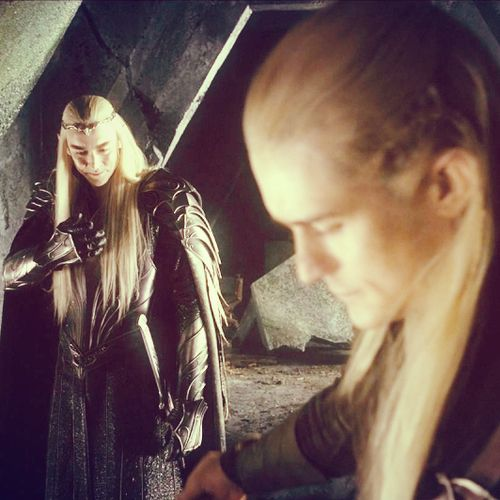 """Thranduil makes the Elvish gesture """"My Heart goes with You"""". as he bids farewell to Legolas."""