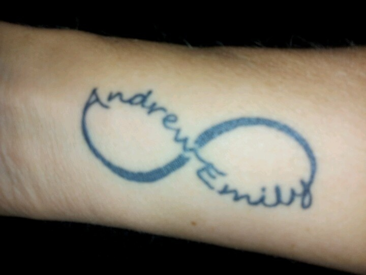 Wrist tattoo.  Infinity sign with kids names.