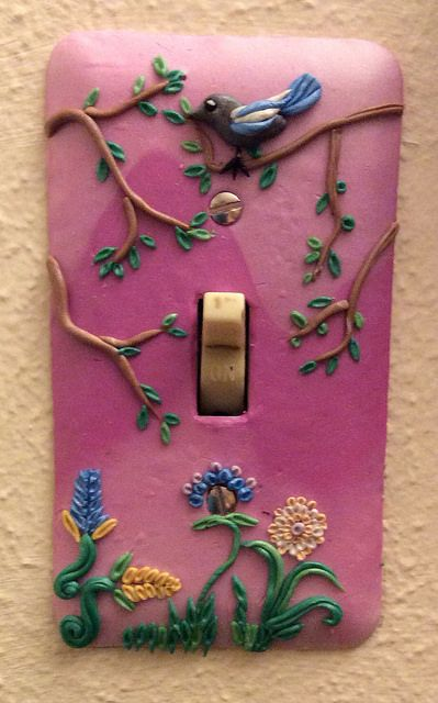 Another switch plate, for the bedroom this time, done in polymer clay with some nice flower embroidery. By Gilladian