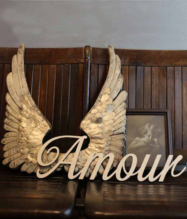 Love is like flying on angel wings. Cut your favorite words out of wood.
