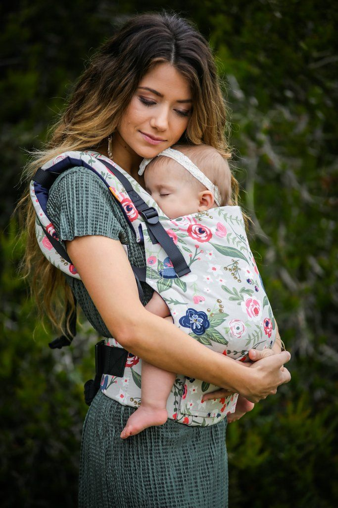 """Two of our favorite brands for baby gear, Ju-Ju-Be and Baby Tula, are releasing a collaborative collection that has us shouting, """"Take all our money!"""" Rosy Posy, the first ever collaboration for these two brands, features all of your favorite Tula babywearing items and Ju-Ju-Be's ever-popular diaper bags and accessories in a sweet, floral print."""