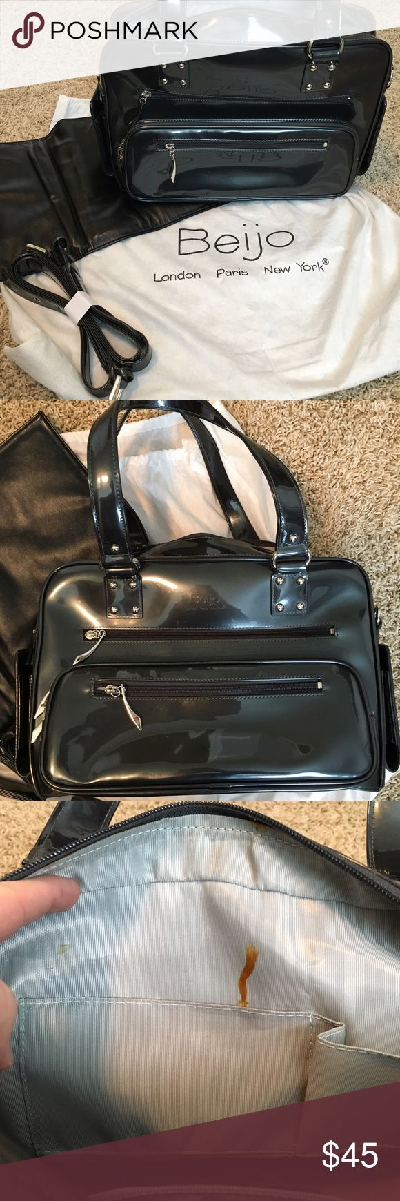 Beijo Style 8321 - Diaper Bag Patent Charcoal/Black Beijo bag. This is in perfect condition other than an interior stain (see photo). Very minimal use and no wear shown on the outside. Changing pad, long strap, and dust bag included. Beijo Bags