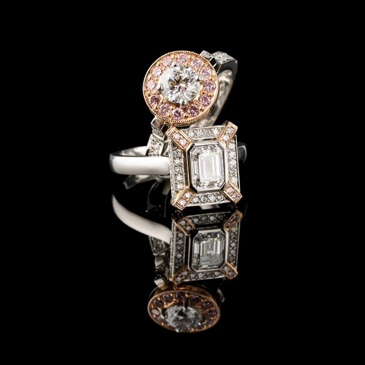 Platinum engagement rings set with white and pink diamonds.